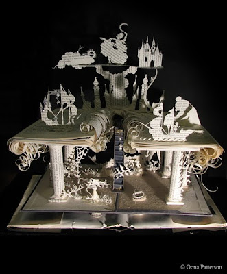 hand cut book art scene wit paper columns, ship and castle
