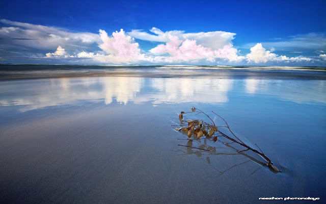 Blue, grey and white reflection on pantai Kuala Ibai