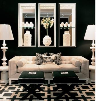 mirrors behind sofa black and white geometric rug in living room