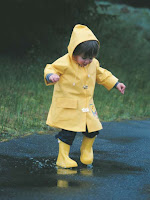 NAMC montessori school clothing guidelines for outdoor play boy in raincoat