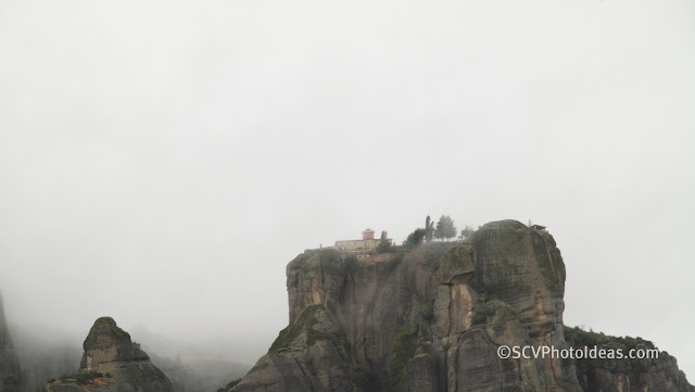 Meteora rocks in the clouds closeup IV