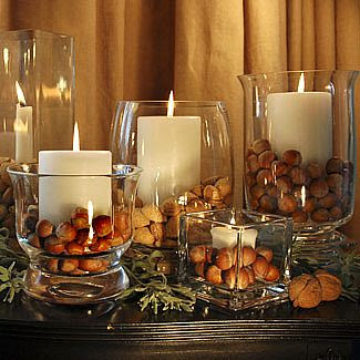 Centerpiece or mantelscape: Pillar candleholders with nuts