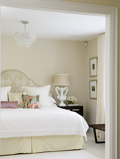 Peaceful neutral bedroom with upholstered headboard by Sarah Richardson