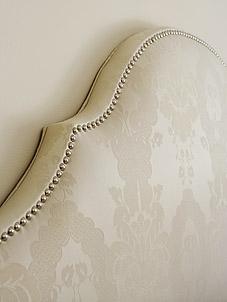 Damask upholstered headboard with nailhead trim - Sarah Richardson