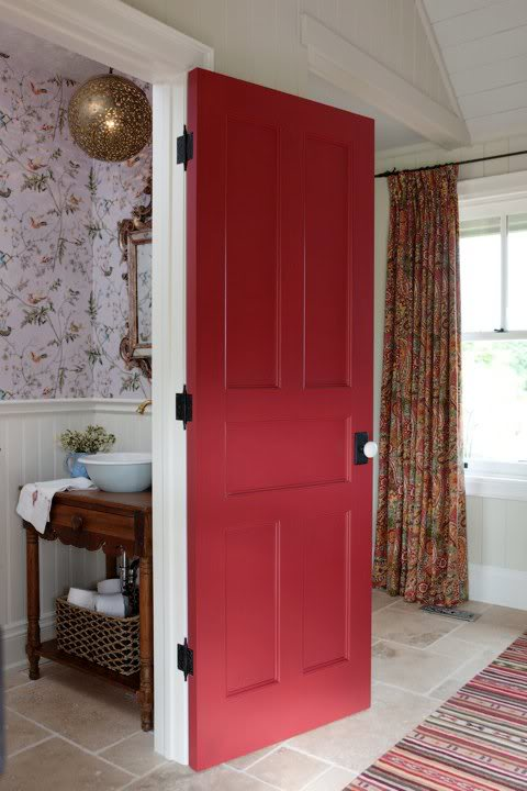 Red painted vintage door to wallpapered powder room in Sarah Richardson's farmhouse