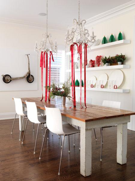 Farm table with chandeliers above strung with red ribbon for Christmas #holidaydecor