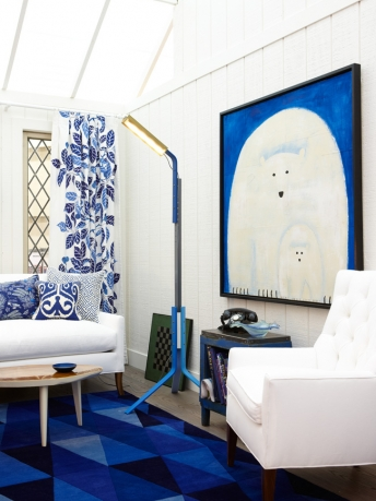 Bright blue decor and polar bear modern art in modern farmhouse design by Sarah Richardson