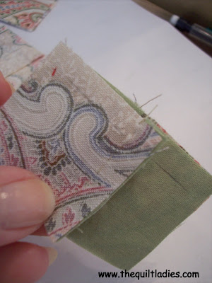 sewing a quilt by hand