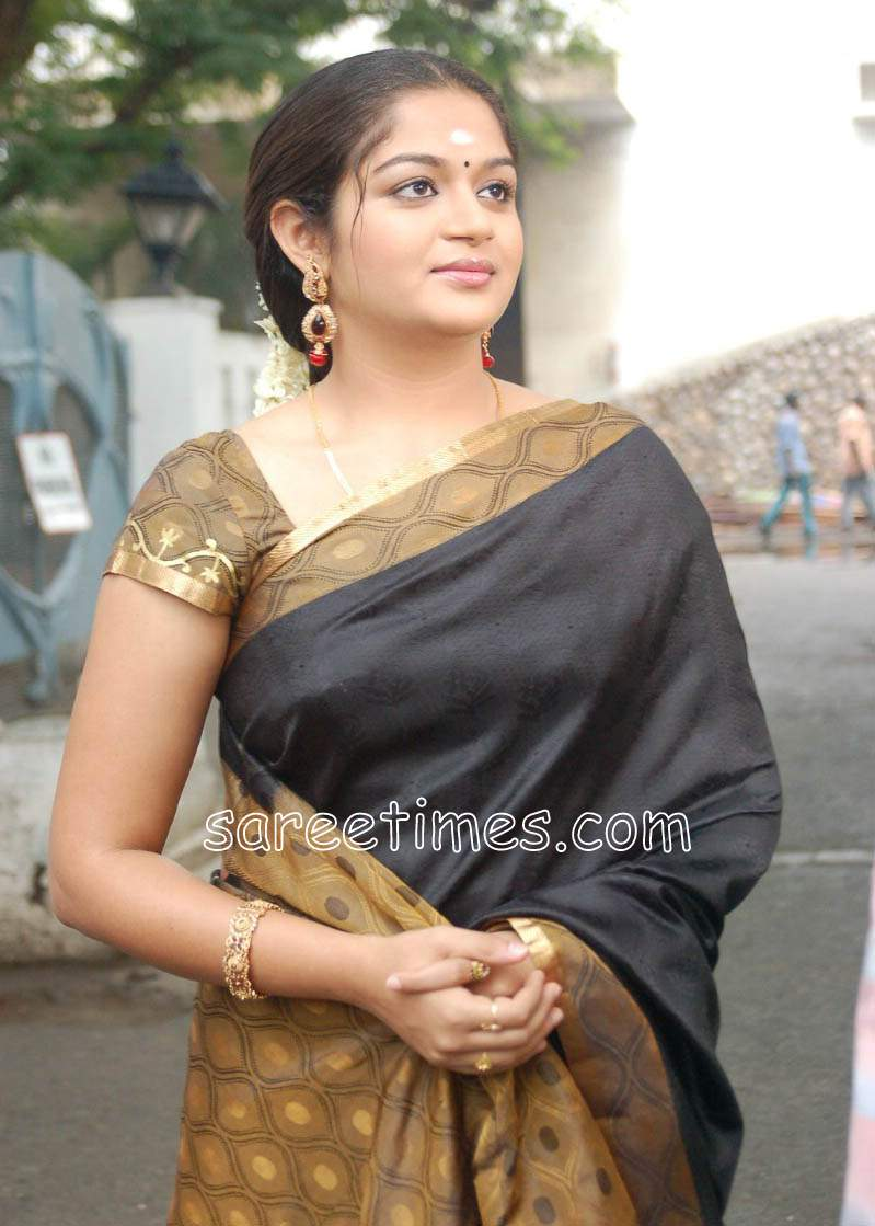 6e7219901798ae South Indian actress Karthika in beautiful black silk saree with contrast  mustard border and pallu.