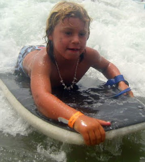 Boogie boarding at Aloha Beach Camp summer camp in Malibu, Los Angeles, California