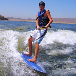 Aloha Beach Camper Brian C. wakesurfs at Castaic Lake. Wakesurfing is an instructional activity offered every Wednesday to Aloha Beach Camp kids.
