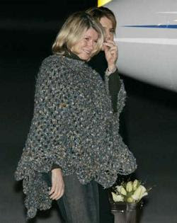 Martha Stewart wearing the Poncho of Shame