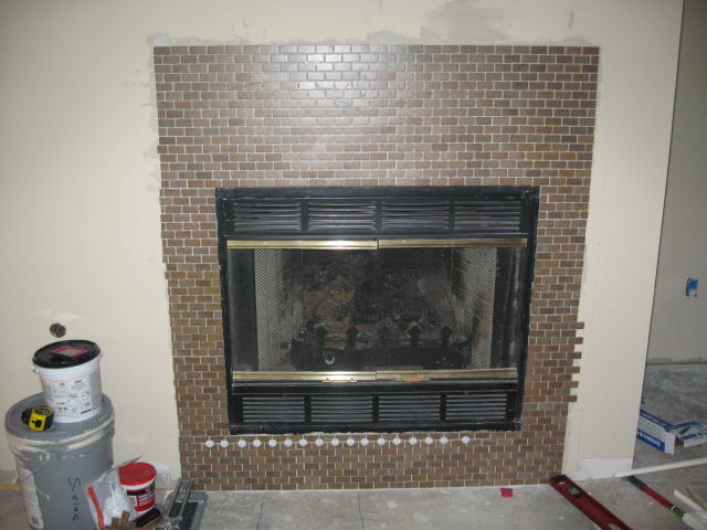 paint brass fireplace doors.  Remodel This House Paint It Black