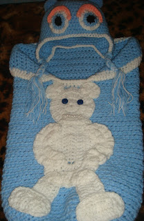 crochet baby cocoon and crochet cap with earflaps for a newborn