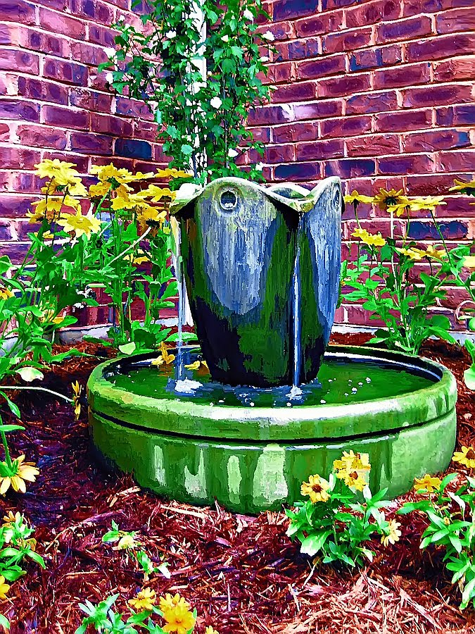 Bubbling urns a summertime joy for Recirculating water feature