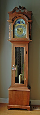 overall view of the walnut grandfather clock