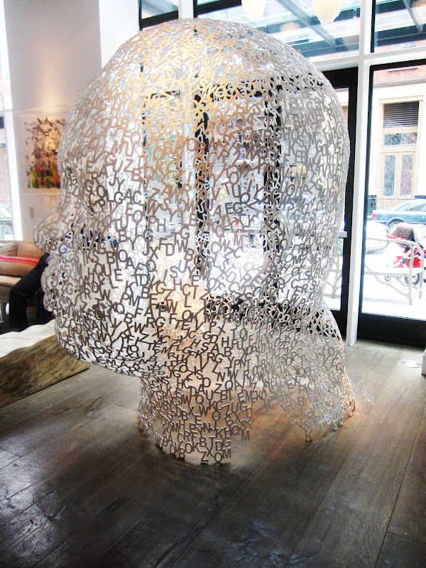 Large steel sculpture of a head made of letters by Jaume Plensa in the Crosby Street Hotel