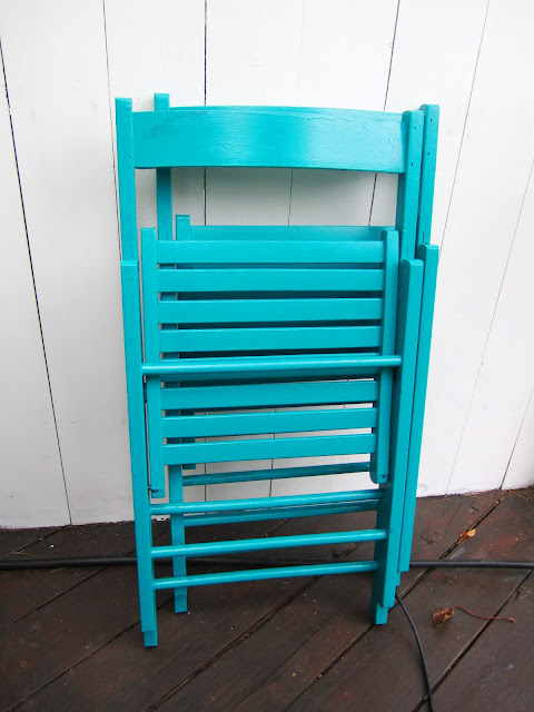 Wood folding chairs painted bright blue