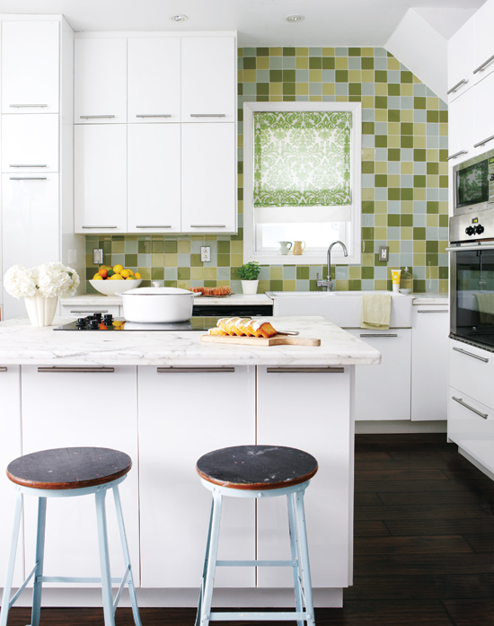 White kitchen with green and yellow square glass tile backsplash