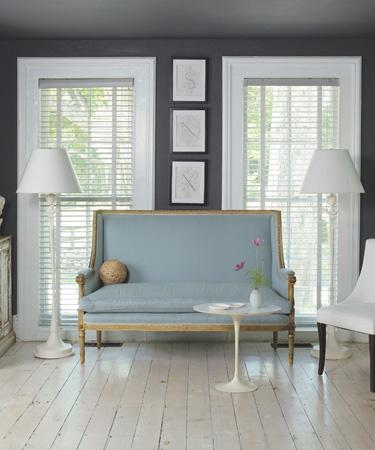 Living Room With Dark Grey Walls White Windows Shades Natural Wood Floor