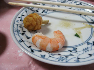 A tiny carved squash and a single shrimp from the osechi for New Year's at Morinaga-san's house.