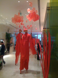 Red stilt walkers