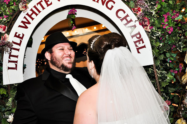 A happy groom smiling during his wedding at the Little white chapel in las vegas