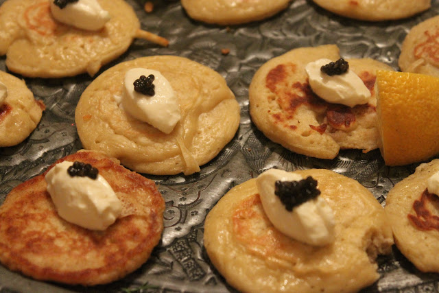 Home made blinis topped with Russian sour cream and real caviar