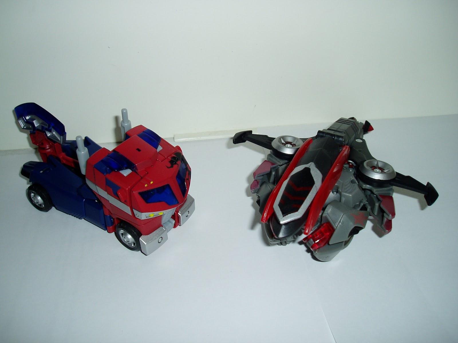Transforming seminarian transformers feature animated - Transformers cartoon optimus prime vs megatron ...