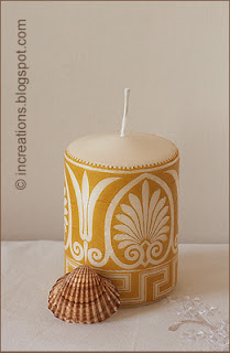 Decorative decoupage candle and a seashell