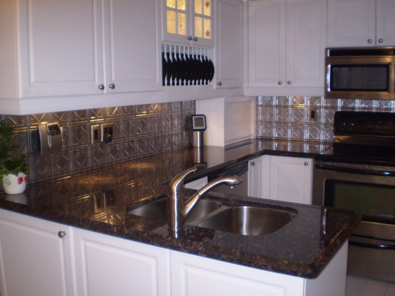 The Granite Gurus: Slab Sunday: Tan Brown granite on Backsplash For Black Granite Countertops And Brown Cabinets  id=78531