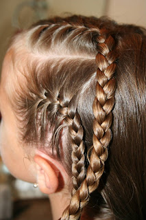 "Side view of girl's hair being styled in ""Criss-Cross French Braids"""