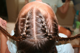 "Top view of girl's hair being styled in ""Criss-Cross French Braids"""