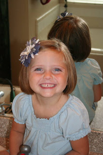Portrait of young girl with A-Line Bob Haircut and bow in her hair