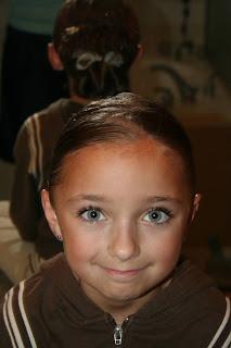 "Portrait of young girl modeling ""Pretzel-Twist Messy Bun"""