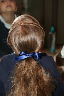 """Back view of young girl modeling """"Hair Headband"""" hairstyle"""
