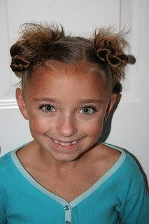 "Portrait of young girl modeling ""4 Messy-Pigtail Twists"" hairstyle"