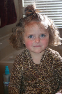 Portrait of young girl's hair being styled into 3-barrel curl hairstyle on her a-line bob