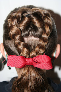 "Back view of Young girl modeling ""Flip Braided Heart"" hairstyle"
