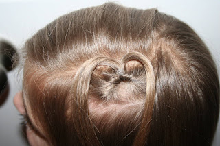 "Top view of young girl modeling ""teen heart"" hairstyle 3"