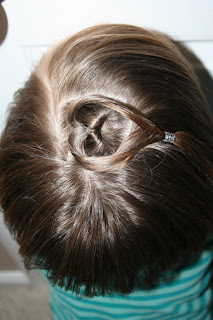 "Top view of girl modeling ""teen heart"" hairstyle 4"