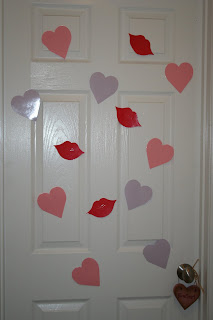 """Picture of family """"heart attack"""" tradition of cut outs of lips and hearts on a door"""