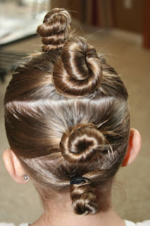"""Back view of young girl modeling """"The Bun-Hawk"""" hairstyle"""