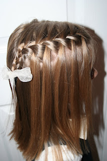 Side view of young girl modeling waterfall braid hairstyles