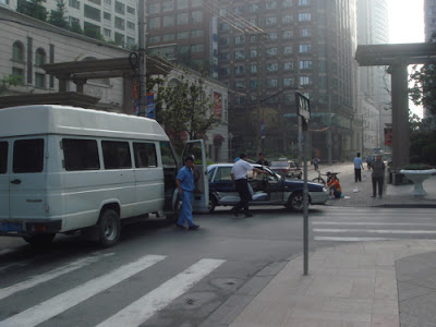 WE HAD ONE MORE ADVENTURE AS WE LEFT OUR SHANGHAI HOTEL FOR THE AIR PORT