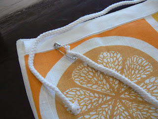 c01656706b Pin the twill tape right around the top edge of the tea towel envelope and  stitch along the top and the bottom to create a channel for your drawstring.