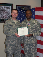 MG Bunting presenting SGT Hill with Purple Heart