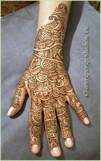 intricate henna tattoo back of hand