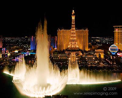 View of Paris Paris Hotel Bellagio fountain from Bellagio Hotel Las Vegas at night