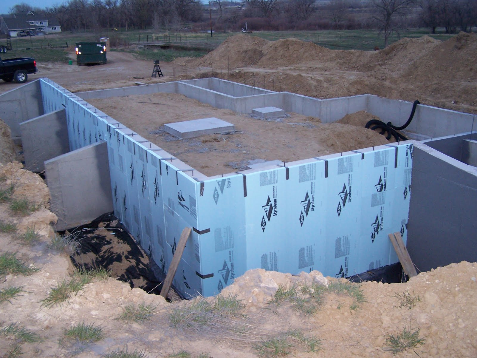 Home construction perimeter drain damproofing and - Exterior basement wall insulation ...